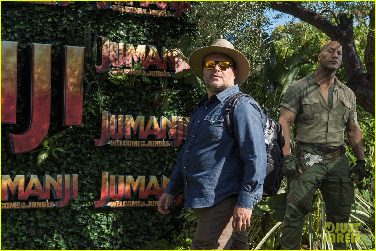 jack black nick jonas face off during jumanji promo 06
