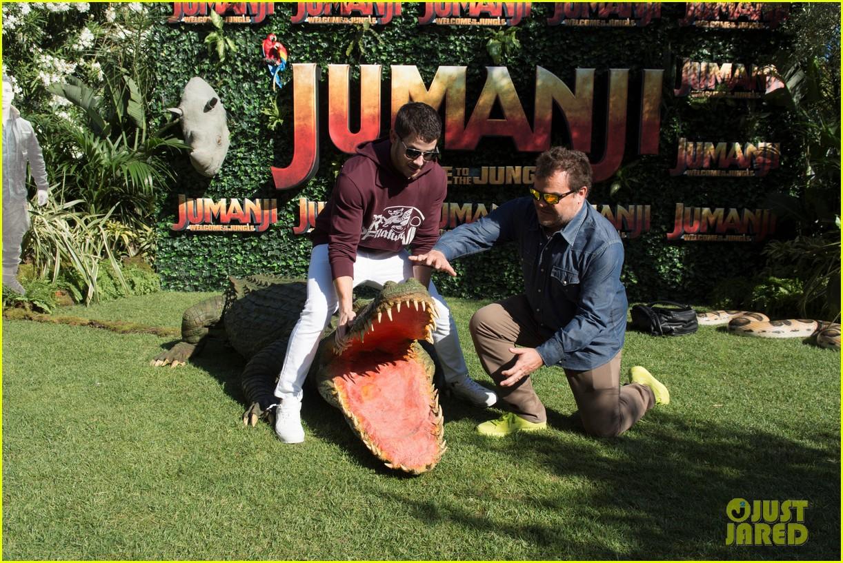 jack black nick jonas face off during jumanji promo 11