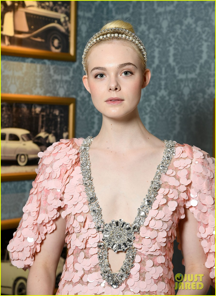 elle fanning gets branded at miu miu fashion show 05