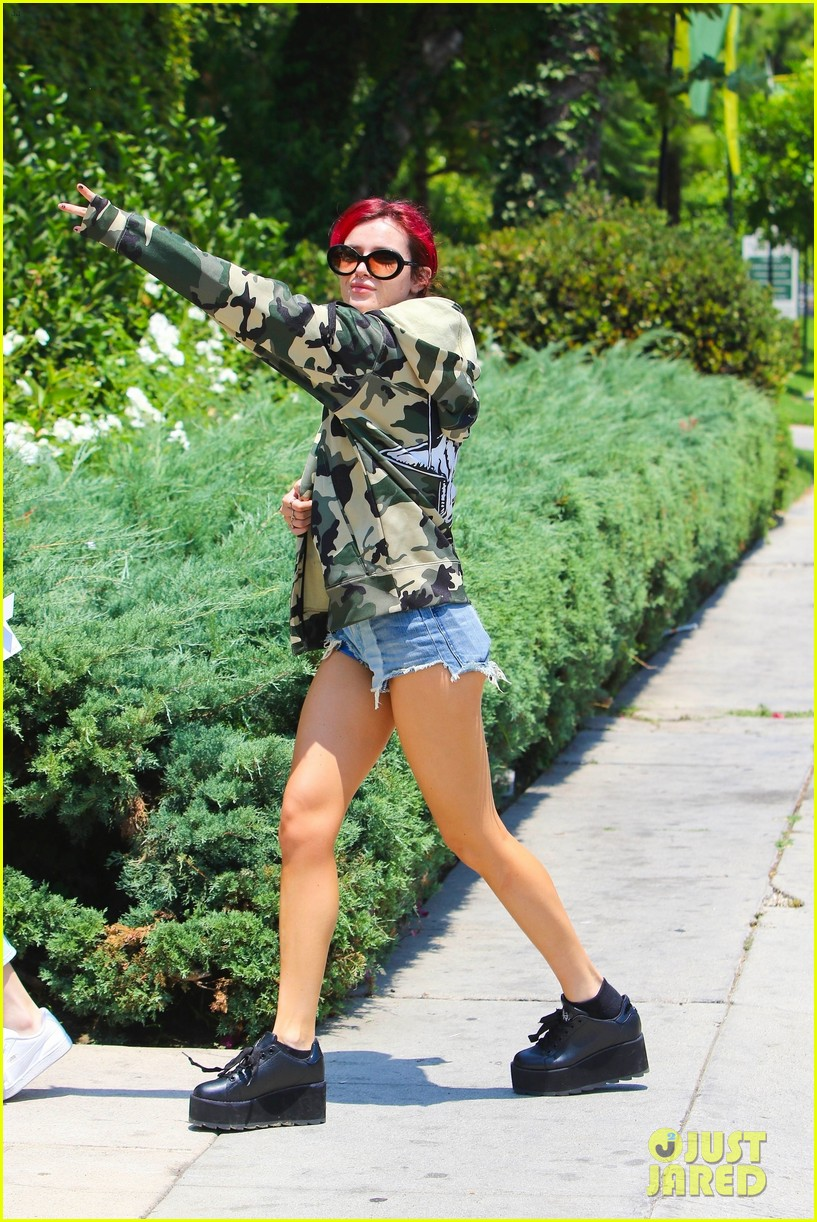bella thorne leaves little to the imagination in plunging 28