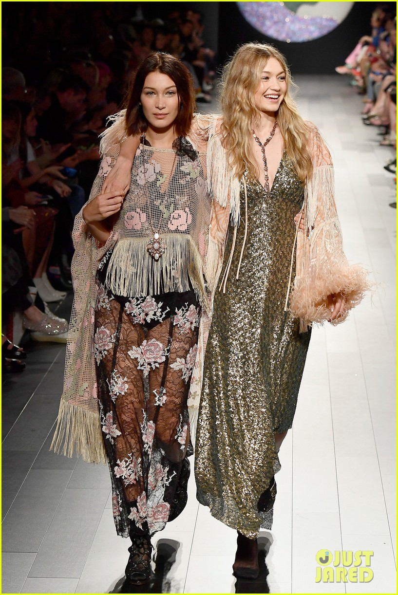 gigi hadid loses high heel mid runway during anna sui show 01