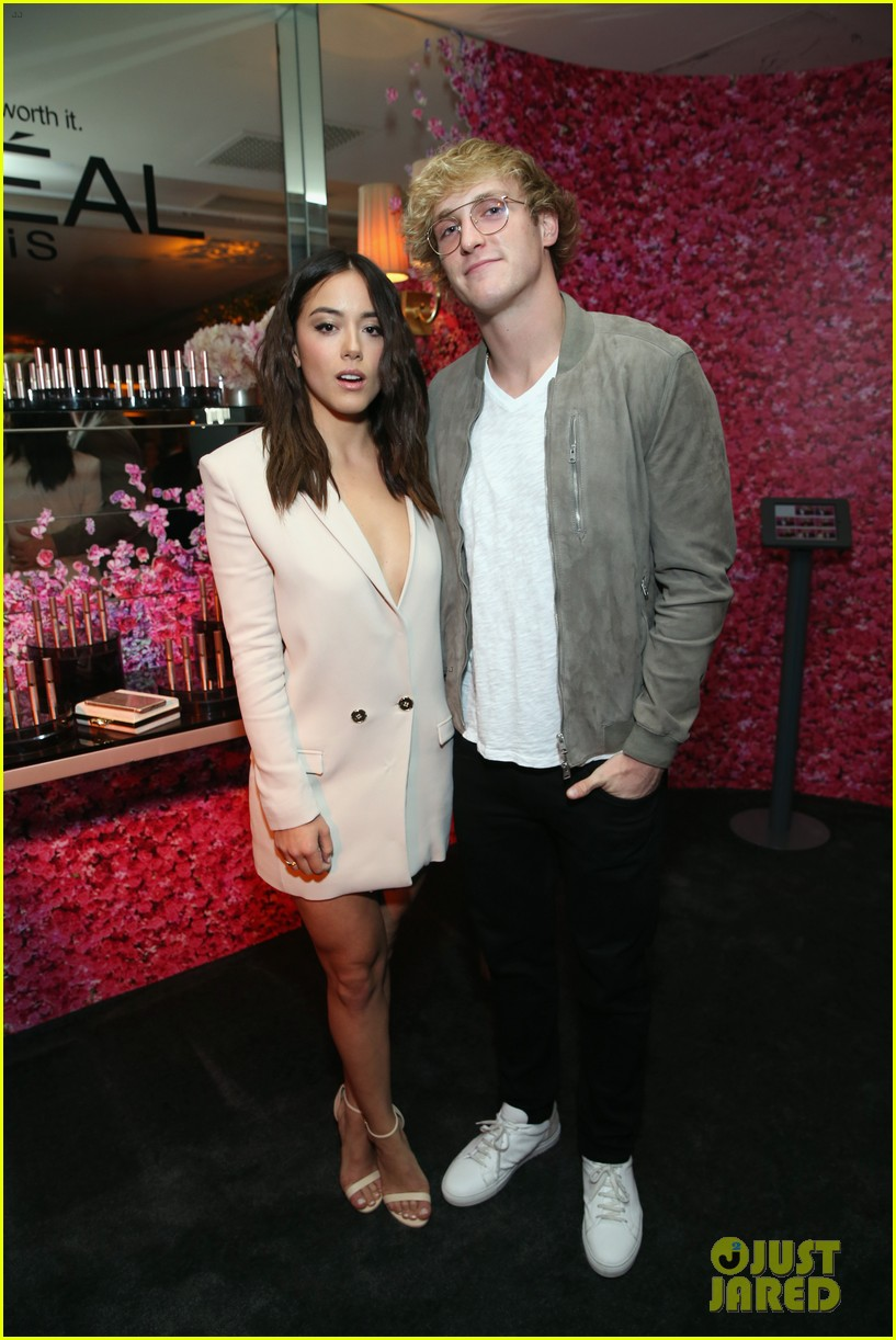 logan paul and chloe bennet strike a pose at pre emmys party 04