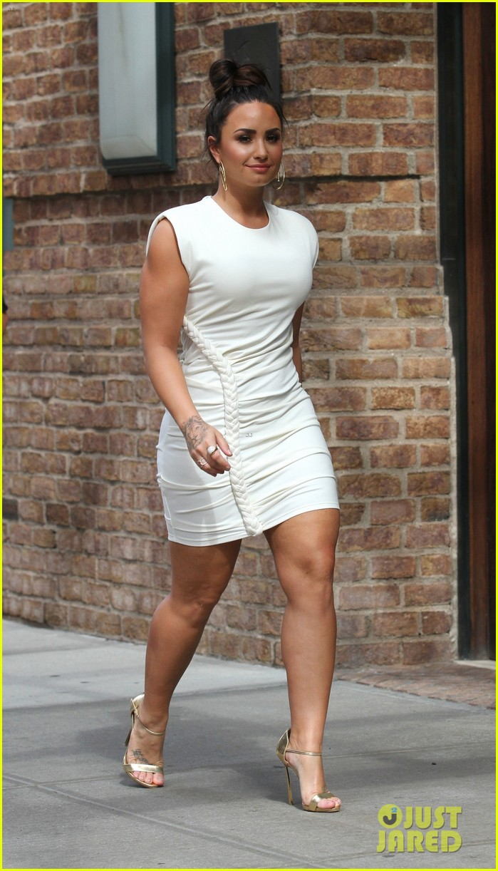 demi lovato wears a dress with a braid down the side 01