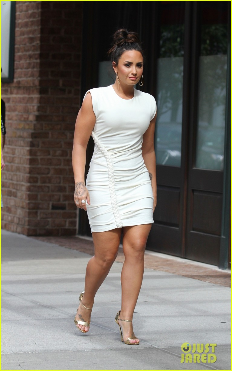 demi lovato wears a dress with a braid down the side 03