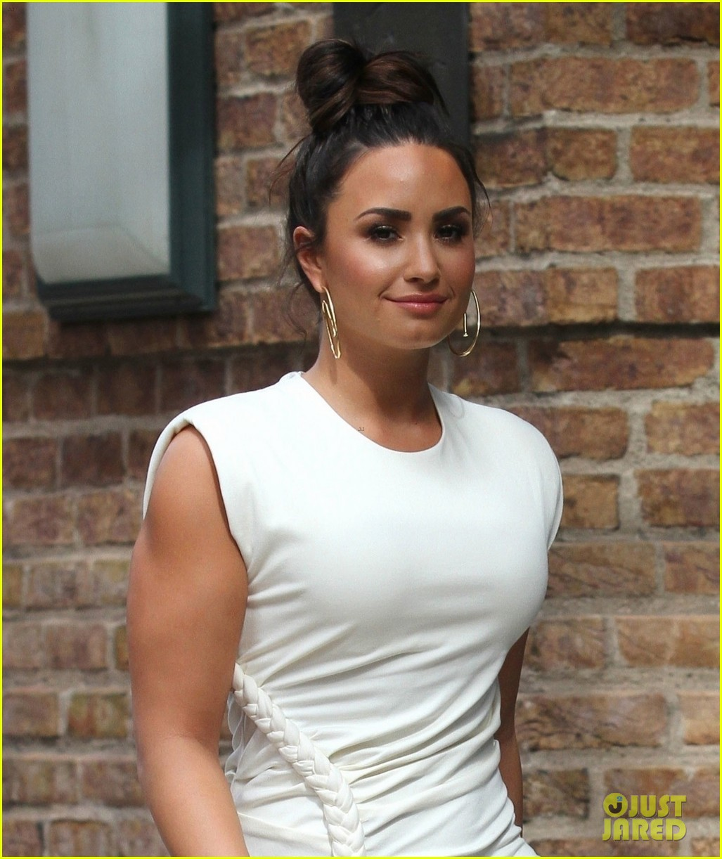 demi lovato wears a dress with a braid down the side 04