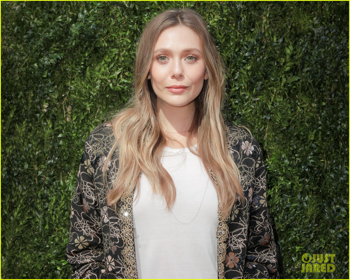 elizabeth olsen dakota fanning tribeca chanel event 32