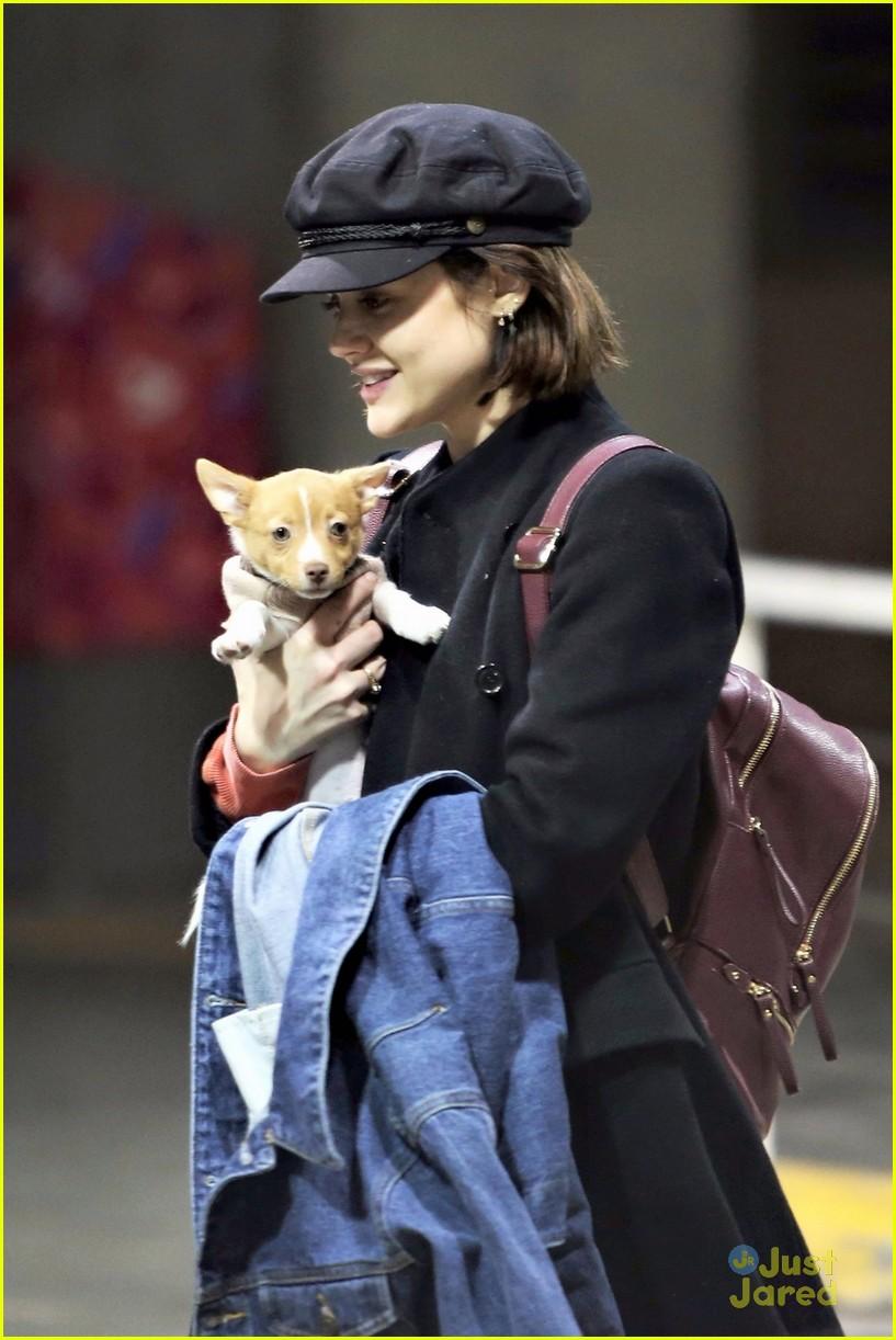 lucy hale puppy kisses vancouver arrival 01