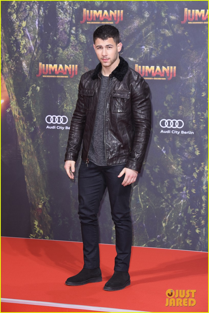 nick jonas dwayne johnson bring jumanji to germany 01