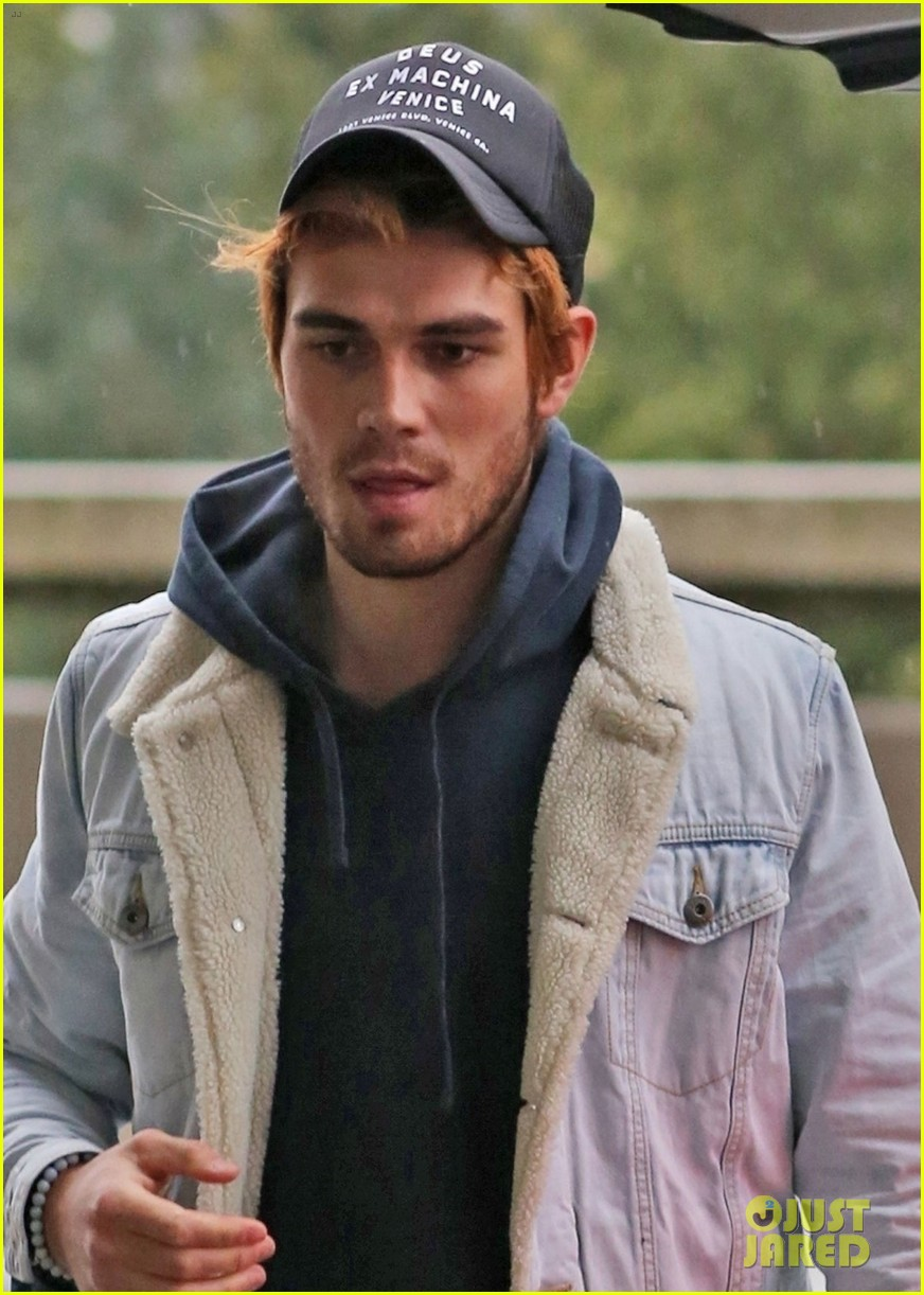kj apa arrives in vancouver with mystery blonde 04