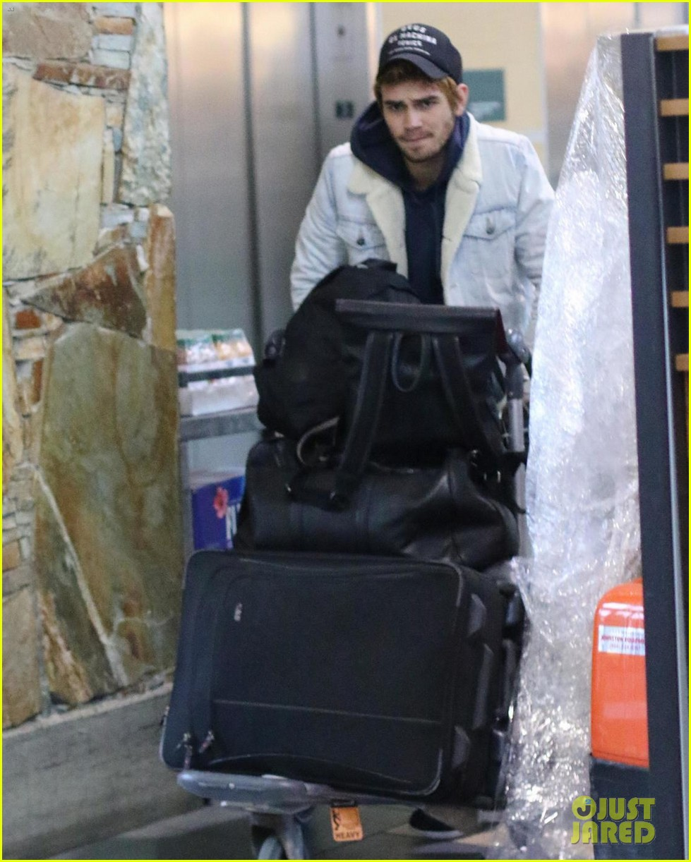 kj apa arrives in vancouver with mystery blonde 10