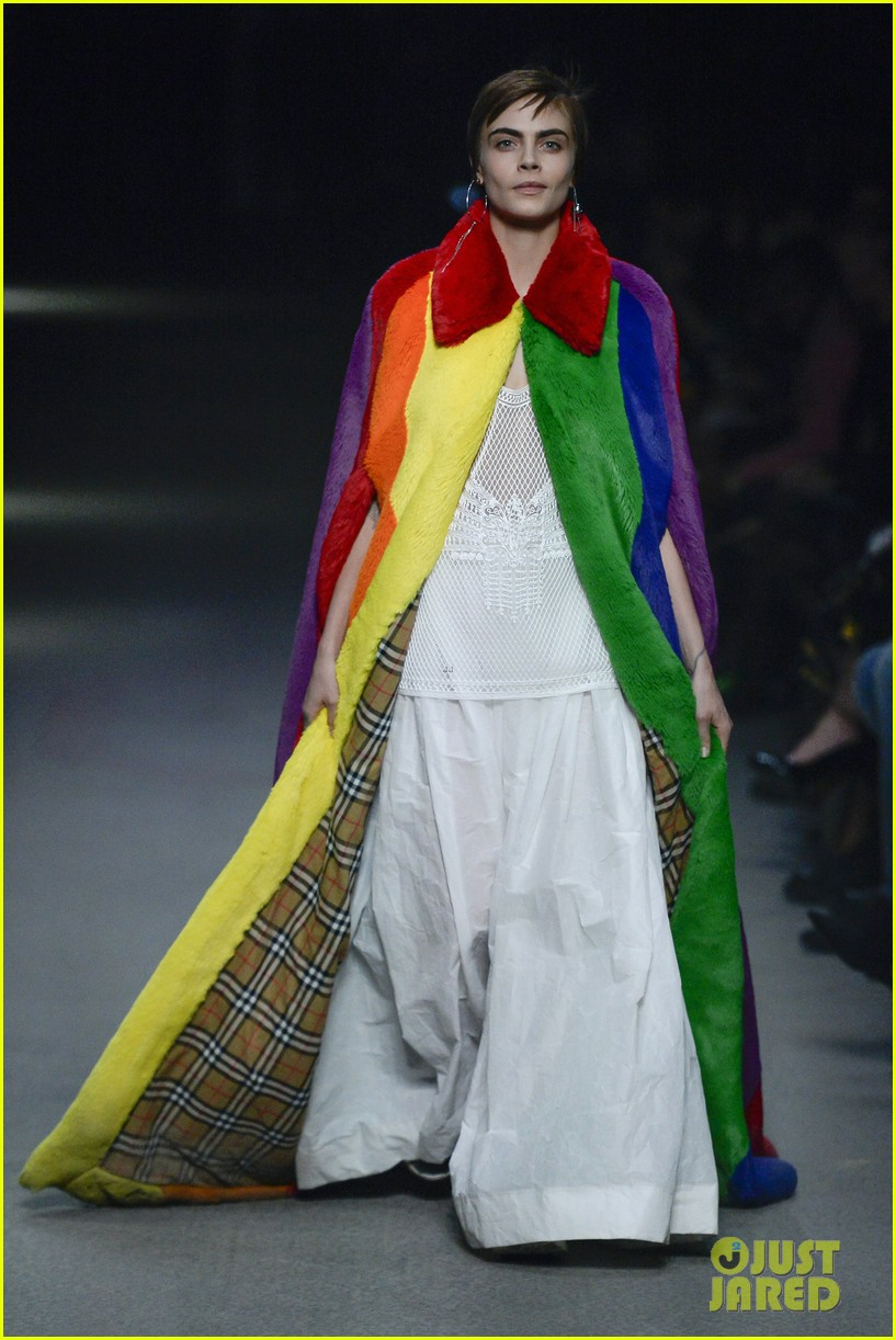 cara delevingne rocks rainbow coat during burberry fashion show