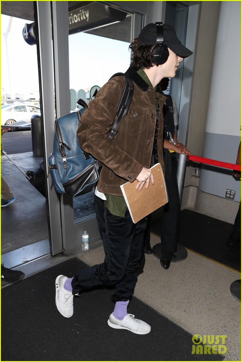 Timothee Chalamet Shows Off His Casual Cool Airport Style Photo