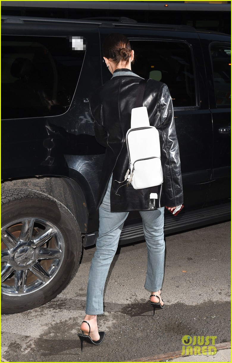 bella hadid rocks denim and leather for modeling agency visit 01