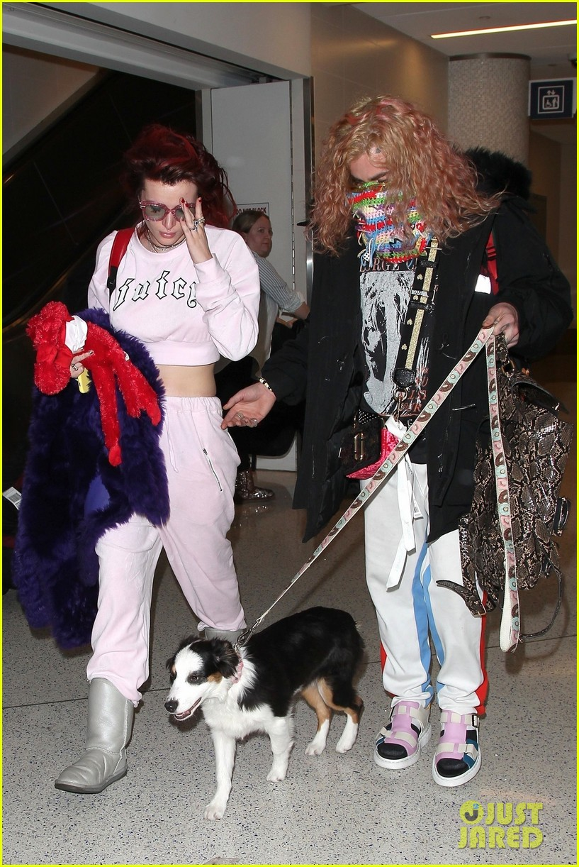 bella thorne arrives back in la with mod sun puppy 01