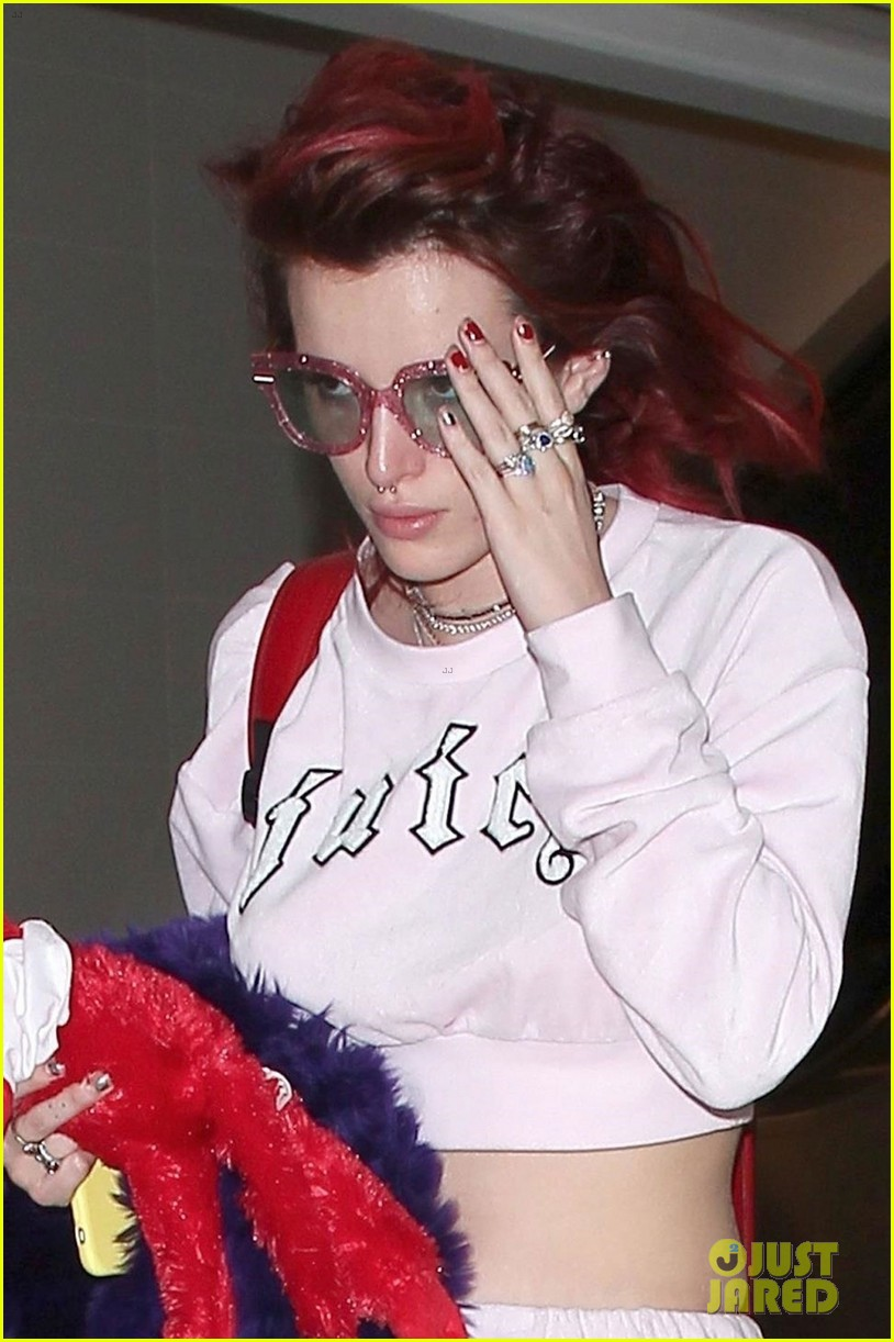 bella thorne arrives back in la with mod sun puppy 02