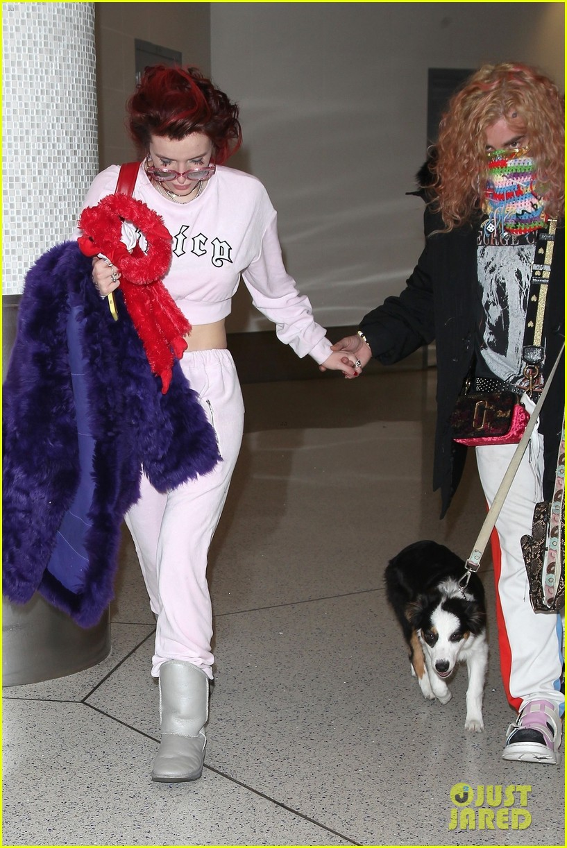 bella thorne arrives back in la with mod sun puppy 03