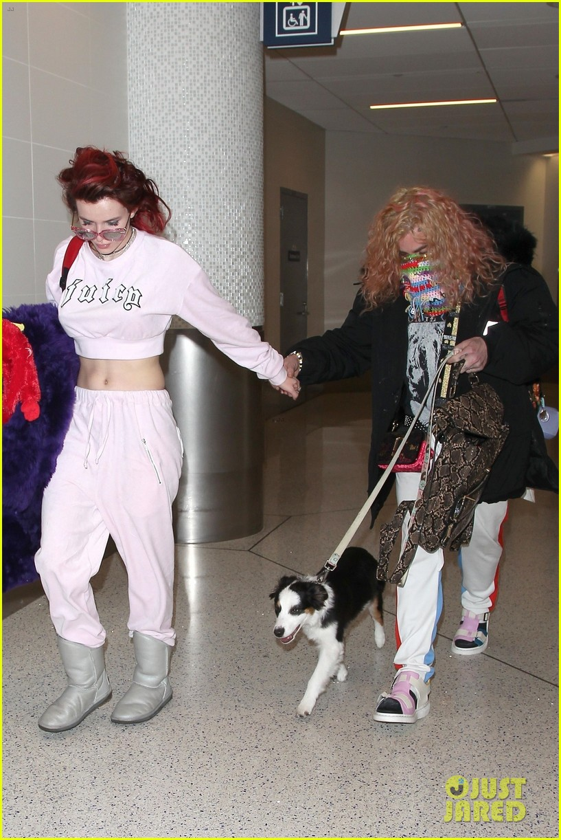 bella thorne arrives back in la with mod sun puppy 05