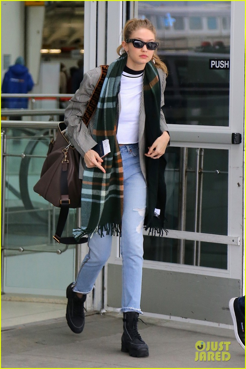 gigi hadid heads back to nyc while sister bella visits disneyland paris 01