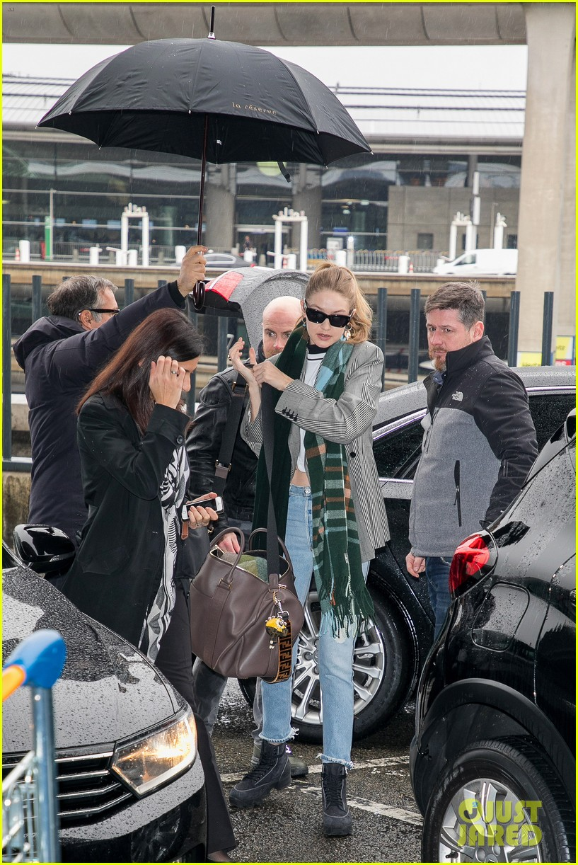 gigi hadid heads back to nyc while sister bella visits disneyland paris 12