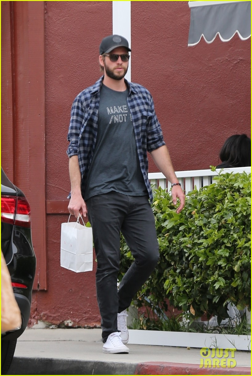 liam hemsworth rocks make love not war t shirt for brentwood shopping trip 01