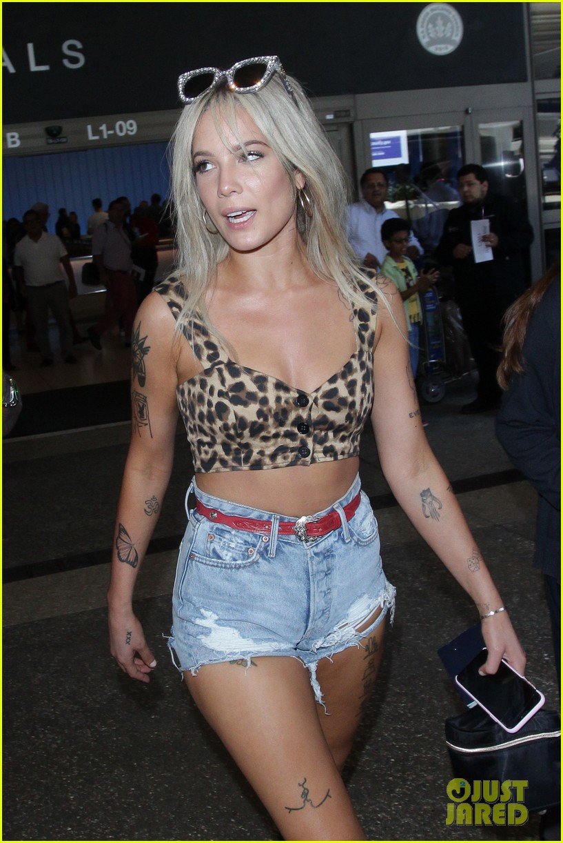 halsey looks fierce in leopard print crop top and cowboy boots at lax airport 03