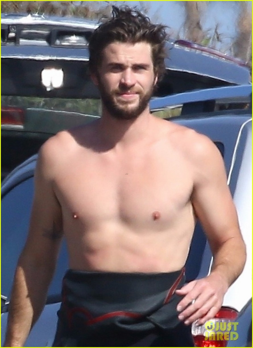liam hemsworth goes shirtless after surfing session 02