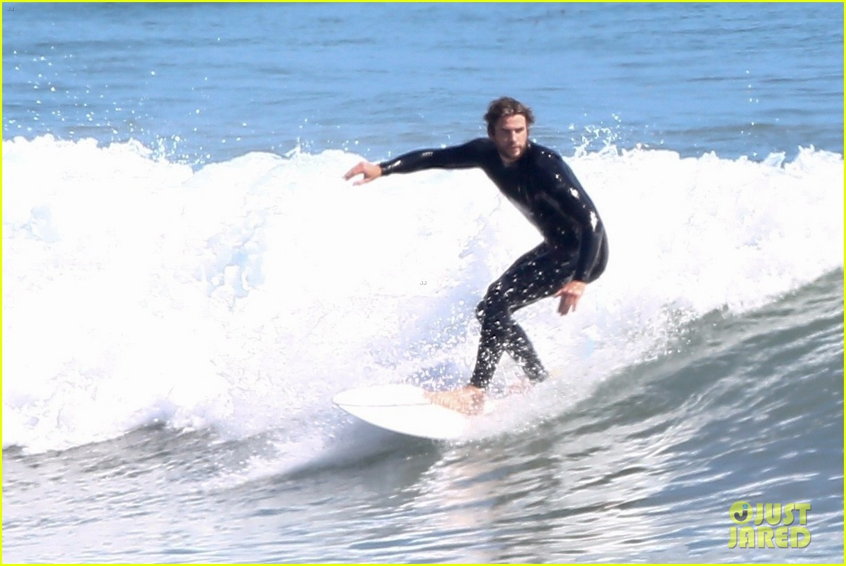 liam hemsworth goes shirtless after surfing session 05