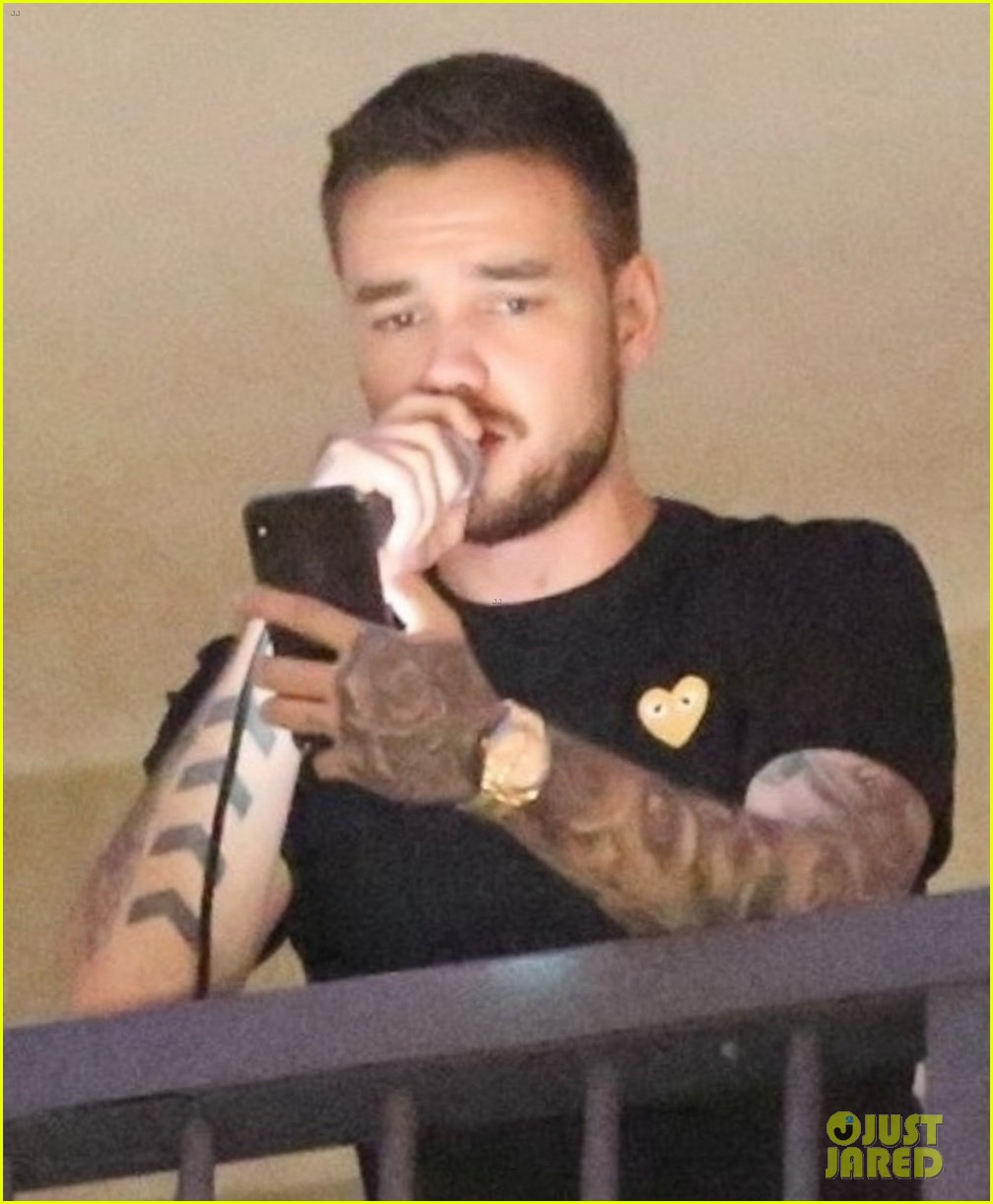 liam payne performs one directions little things from hotel balcony 02