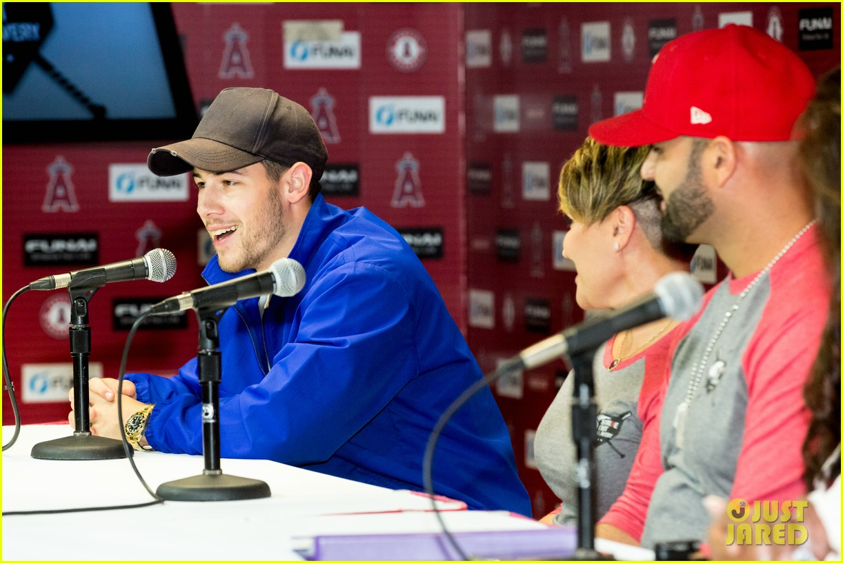 nick jonas helps strike out slavery at press conference ahead of concert 14