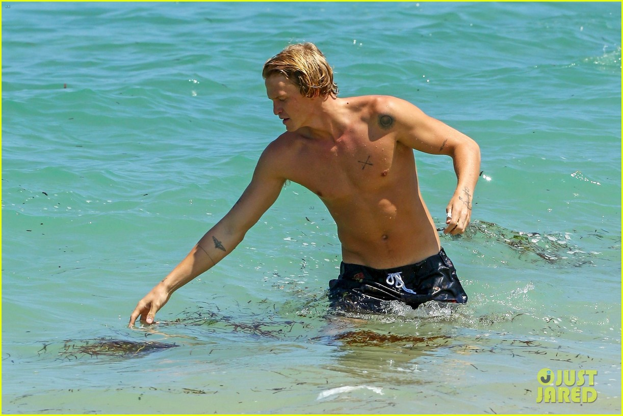cody simpson hits the beach with girlfriend clair wuestenberg 08