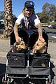 justin bieber poses with two dogs in a stroller before soccer game02