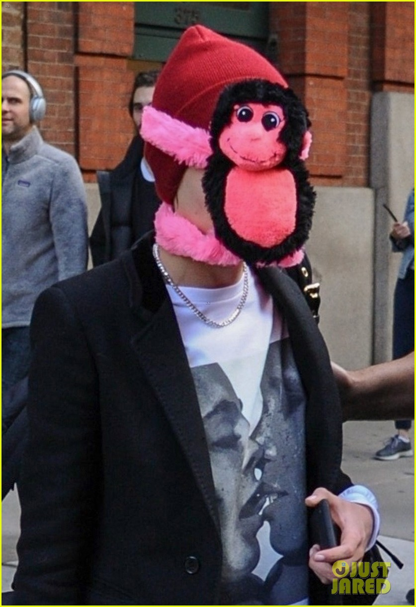 cara delevingne makes ashley benson laugh while stepping out with stuffed monkey on her face07