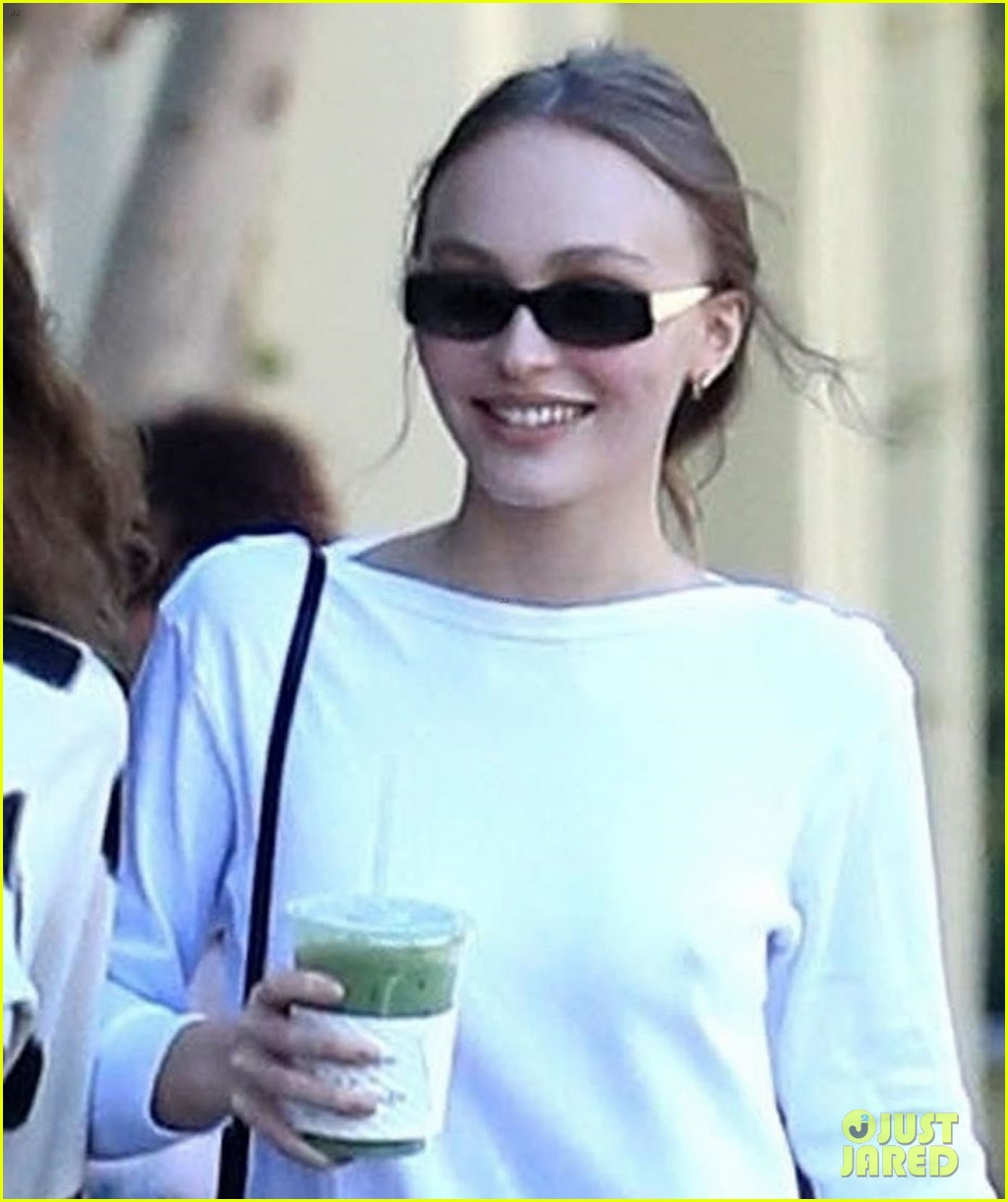lily rose depp keeps it casual while picking up a green drink 04