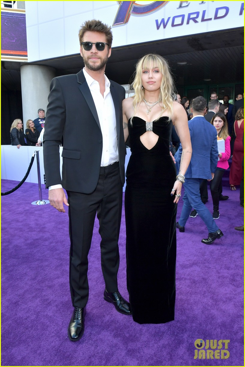 miley cyrus and liam hemsworth couple up for avengers endgame world premiere 01