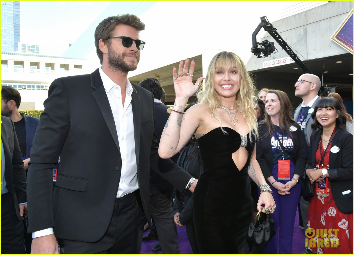miley cyrus and liam hemsworth couple up for avengers endgame world premiere 02