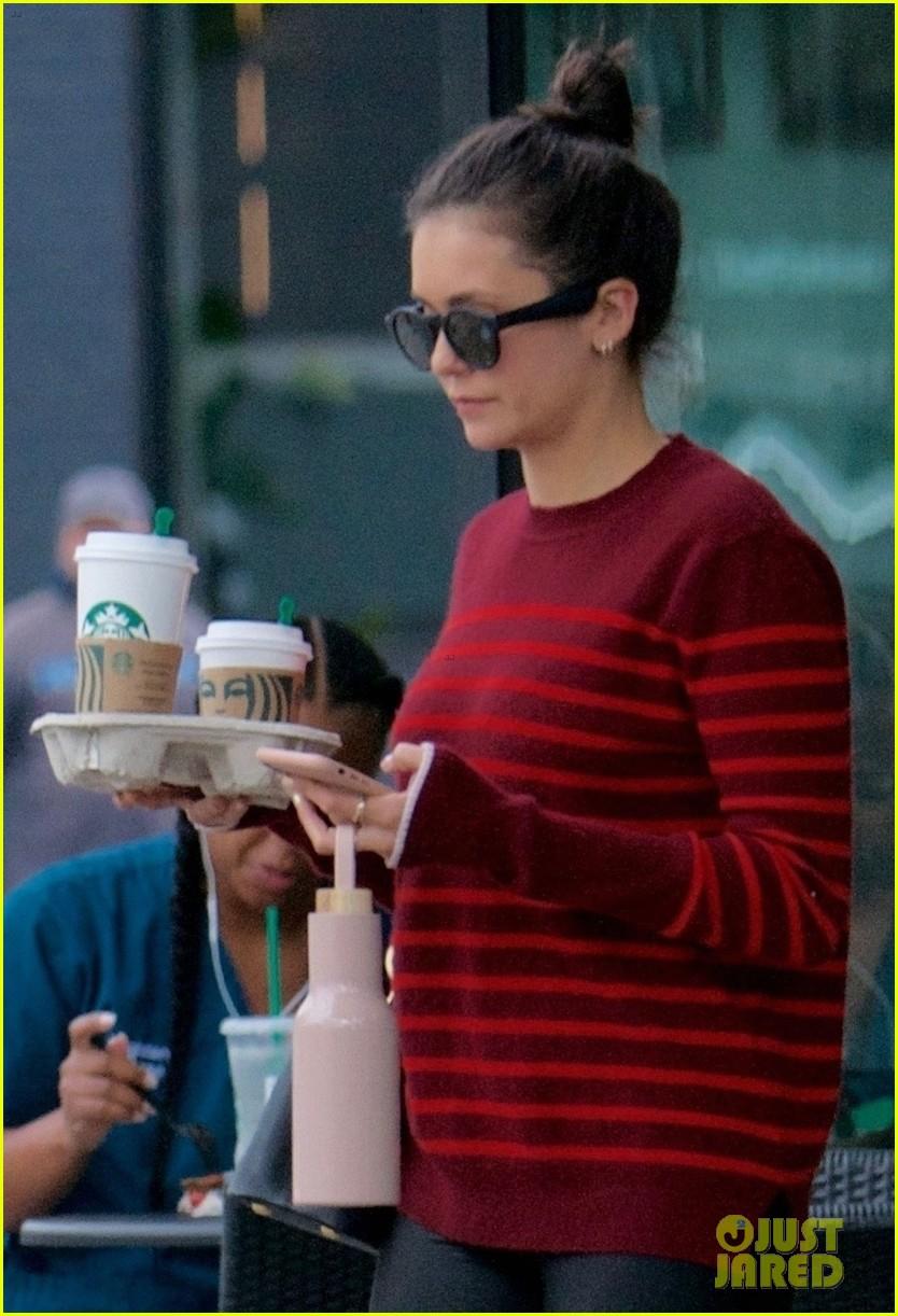 nina dobrev has her hands full after starbucks coffee run 02