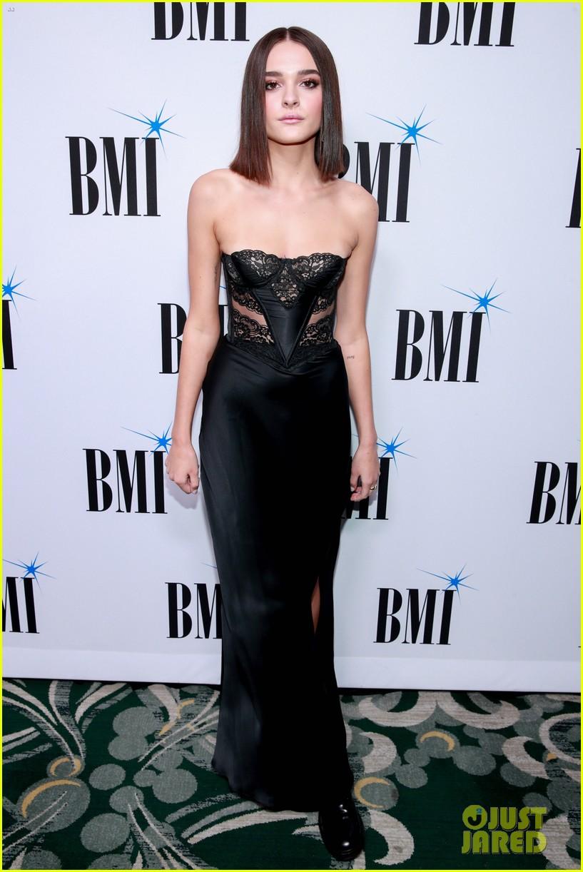 charlie puth charlotte lawrence walk carpet separately at bmi pop awards 02