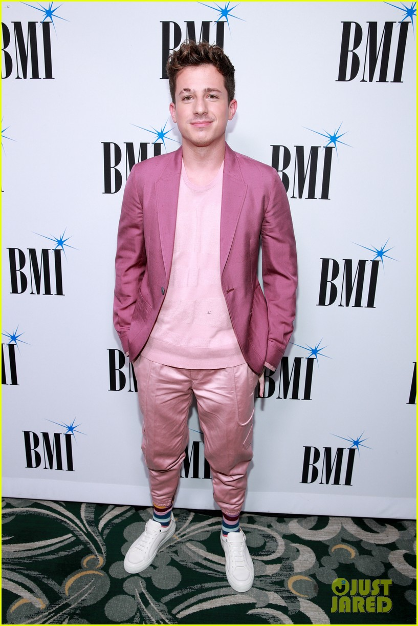 charlie puth charlotte lawrence walk carpet separately at bmi pop awards 06