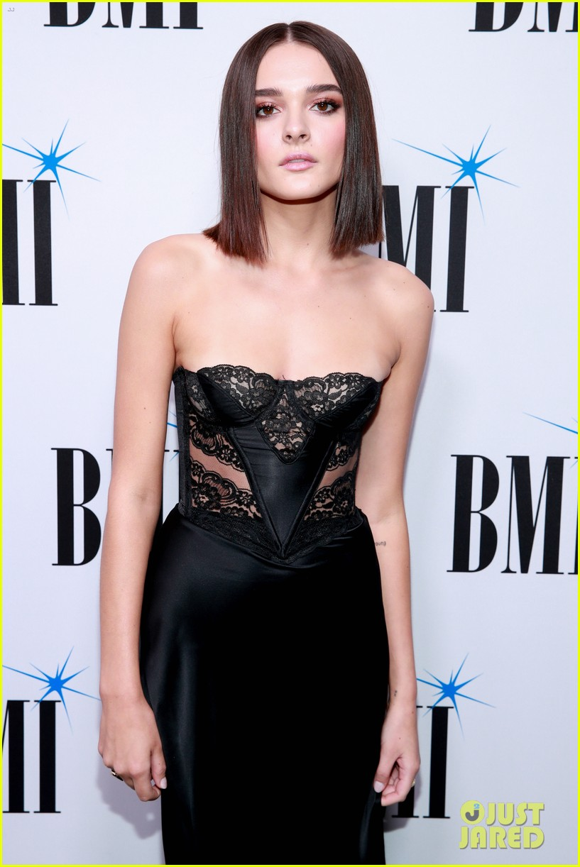 charlie puth charlotte lawrence walk carpet separately at bmi pop awards 10