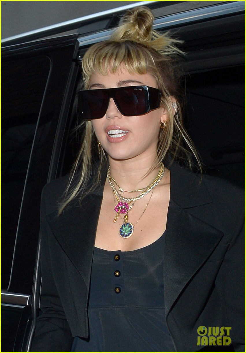 miley cyrus rocks little black dress for night out in london 04