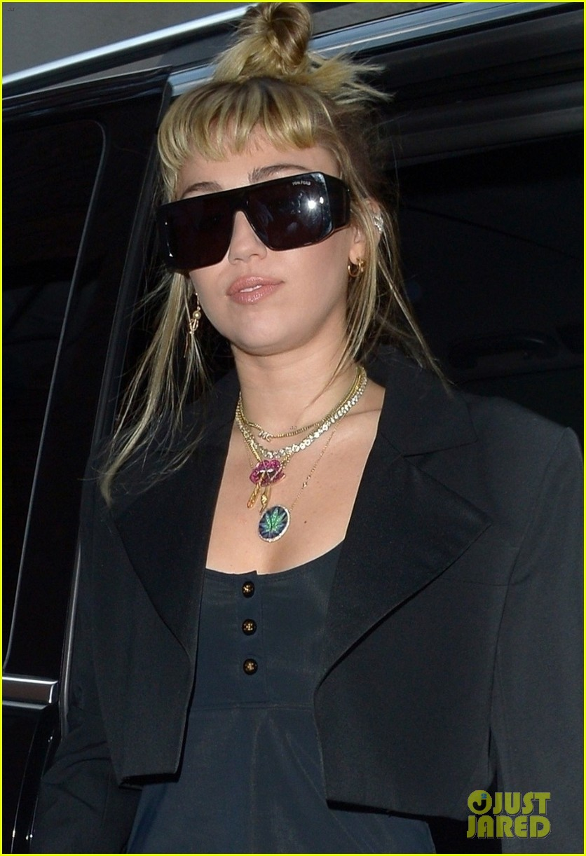 miley cyrus rocks little black dress for night out in london 08
