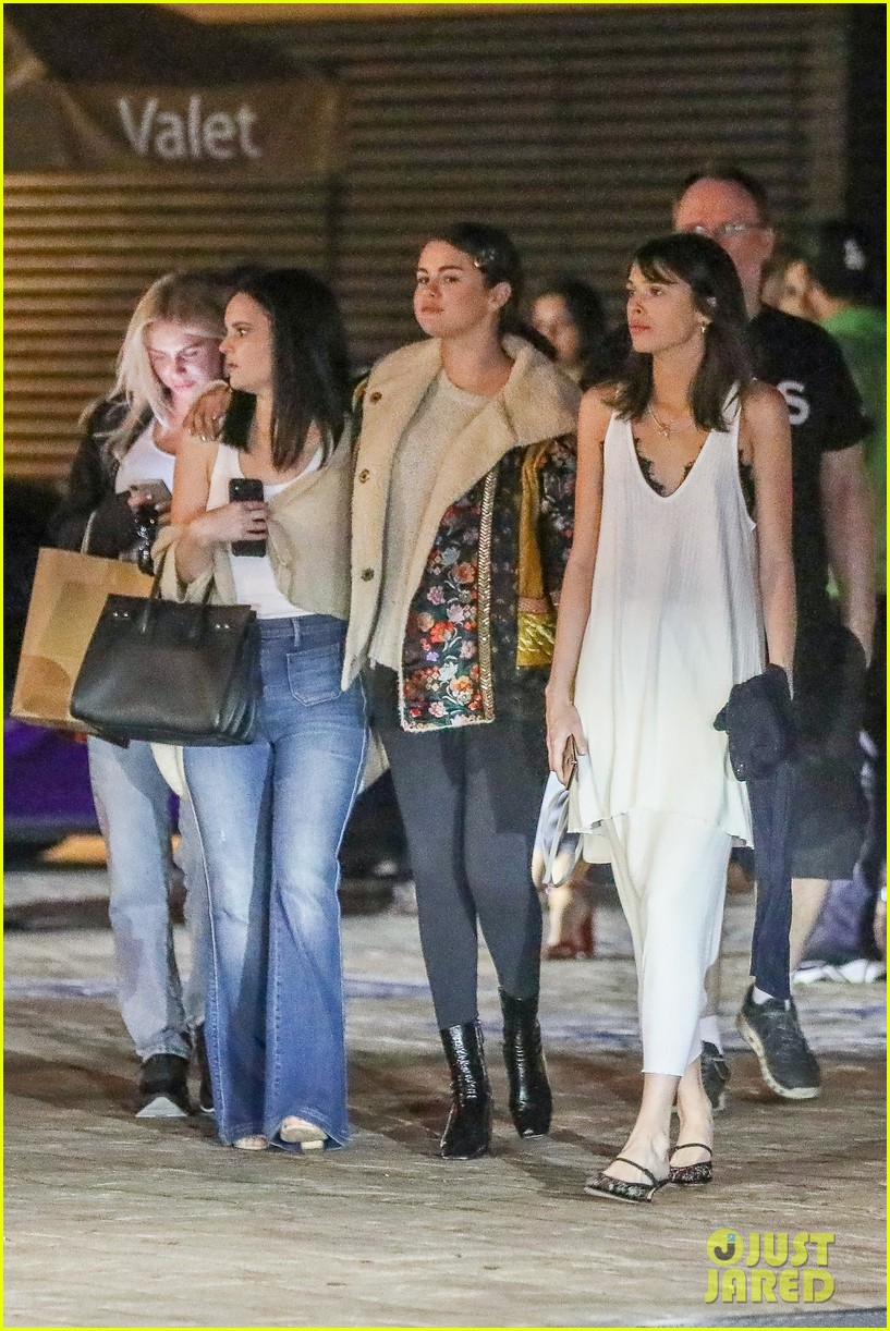 selena gomez keeps close to friends during girls night 01