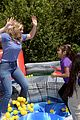 bailee madison lauren alaina help distribute backpackswith blessings in a backpack 08