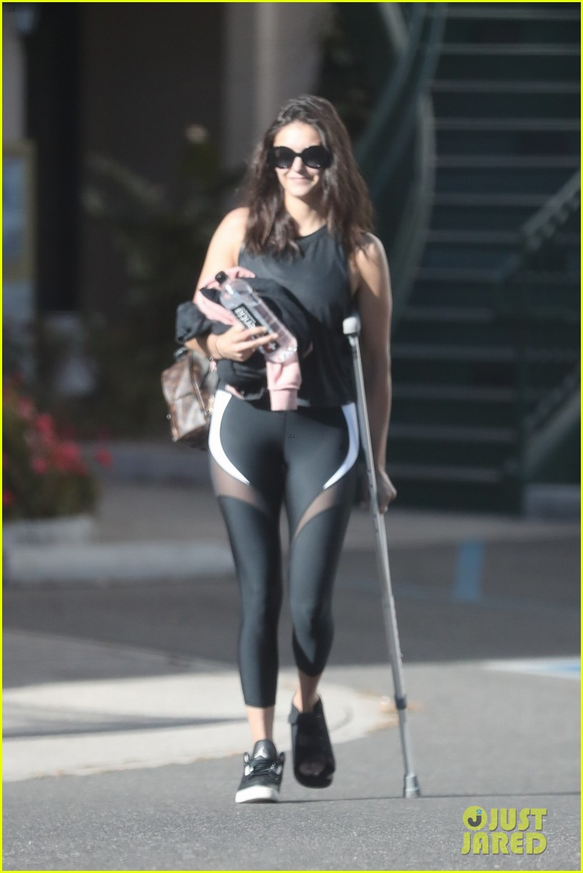 nina dobrev steps out on crutches after injuring her foot 01