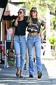 miley cyrus kaitlynn carter wrap their arms around each other afternoon stroll 02
