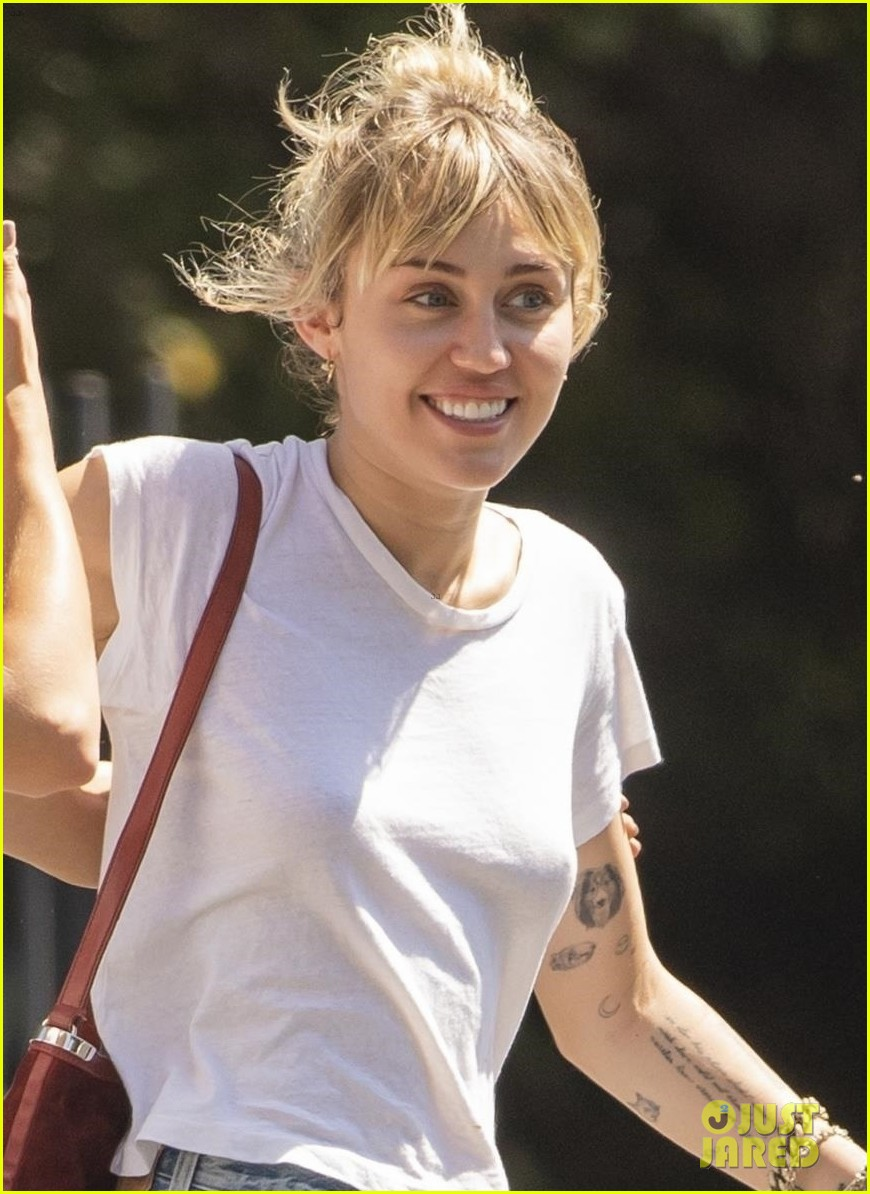 miley cyrus wraps her arms around kaitlynn carter during afternoon outing 01