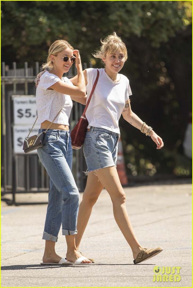 miley cyrus wraps her arms around kaitlynn carter during afternoon outing 02