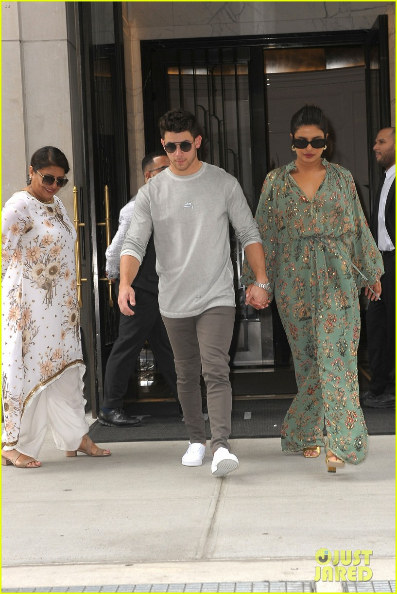 nick jonas priyanka chopra hotel exit best dressed honors 01