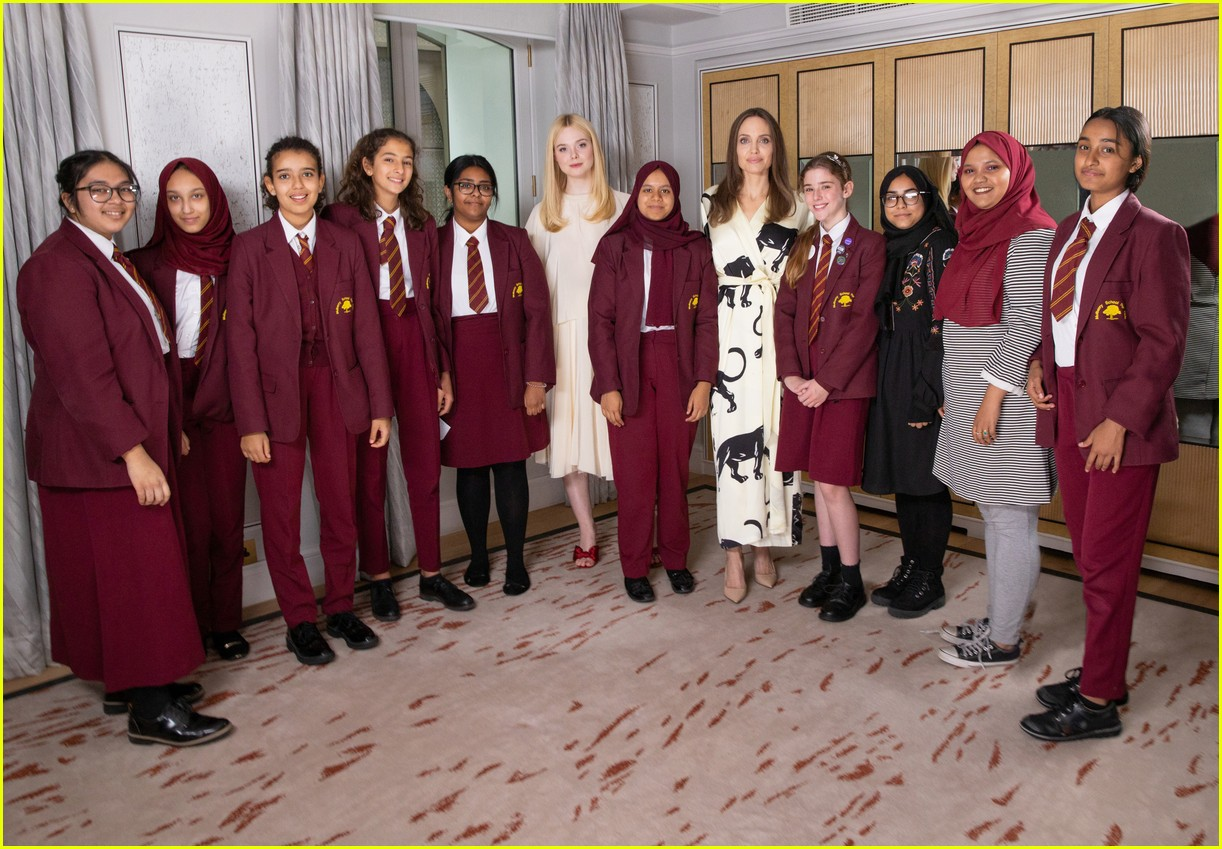 angelina jolie elle fanning visit london school girls international day of the girl 01