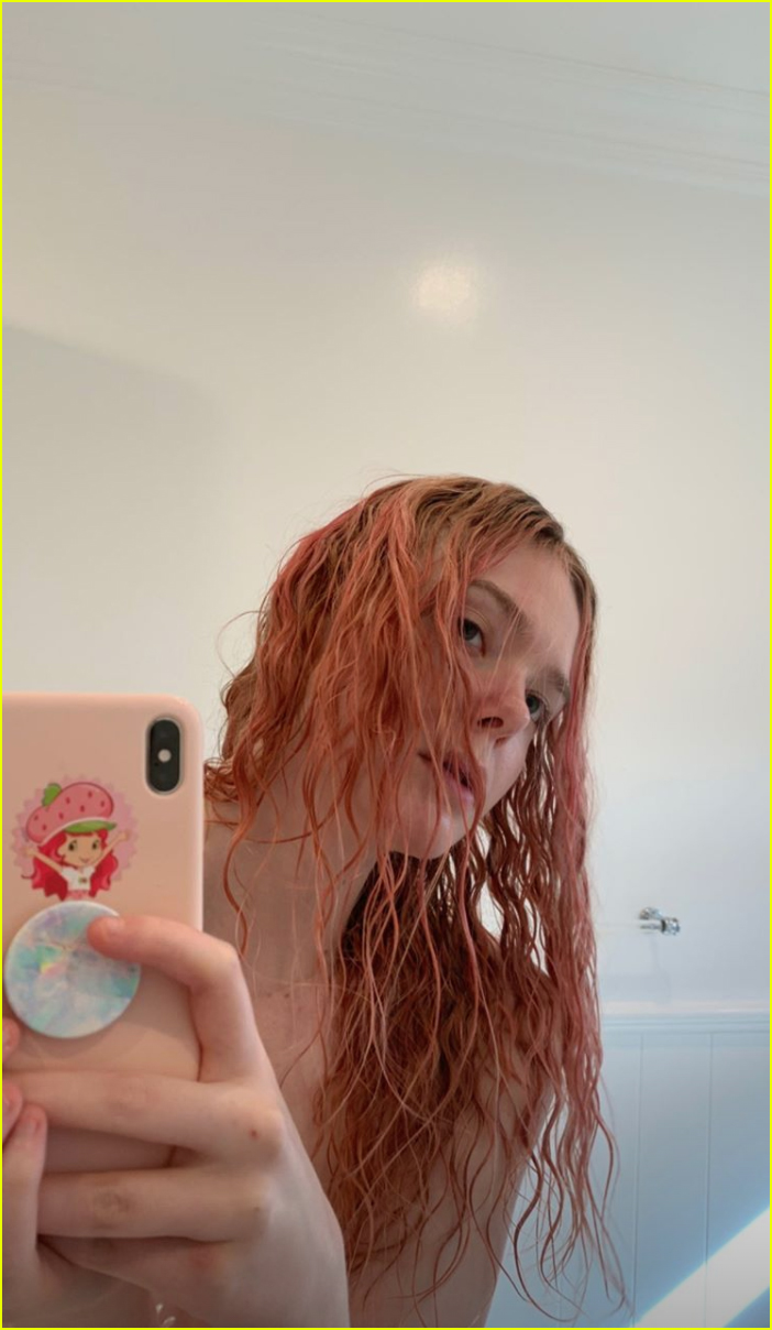 elle fanning debuts newly dyed pink hair